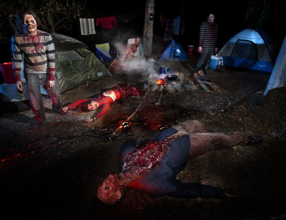 "Photo -   This September 2012 photo provided by Universal Studios Hollywood shows an attraction inspired by the AMC zombie series ""The Walking Dead."" Guests attending the California theme park's Halloween Horror Nights are dropped off by the ""Terror Tram"" to wander around the park's studio backlot, where they can encounter the ghoulish zombies. (AP Photo/Universal Studios Hollywood)"