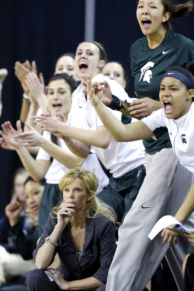 Photo - Michigan State head coach Suzy Merchant, bottom, watches her team during the first half of an NCAA college basketball game against Penn State in the Big Ten Conference tournament in Hoffman Estates, Ill., Saturday, March 9, 2013. Michigan State won 54-46. (AP Photo/Nam Y. Huh)