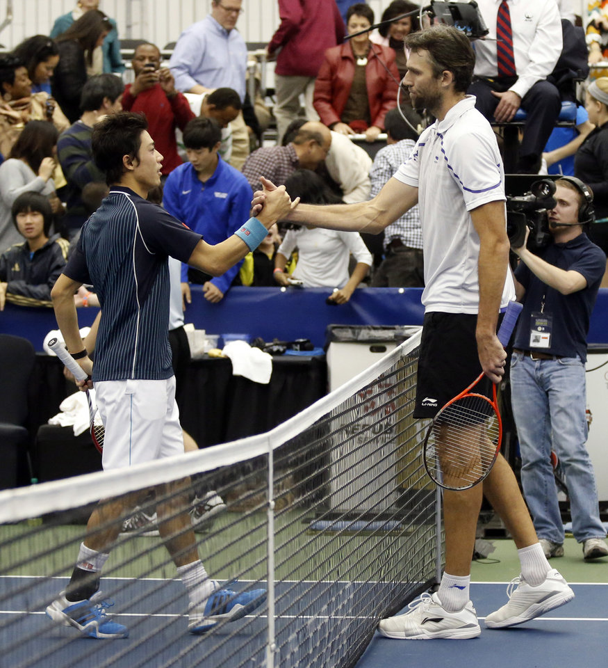 Photo - Ivo Karlovic, right, of Croatia, congratulates Kei Nishikori, of Japan, for winning the singles final 6-4, 7-6 (0) at the U.S. National Indoor Tennis Championships, Sunday, Feb. 16, 2014, in Memphis, Tenn. (AP Photo/Rogelio V. Solis)