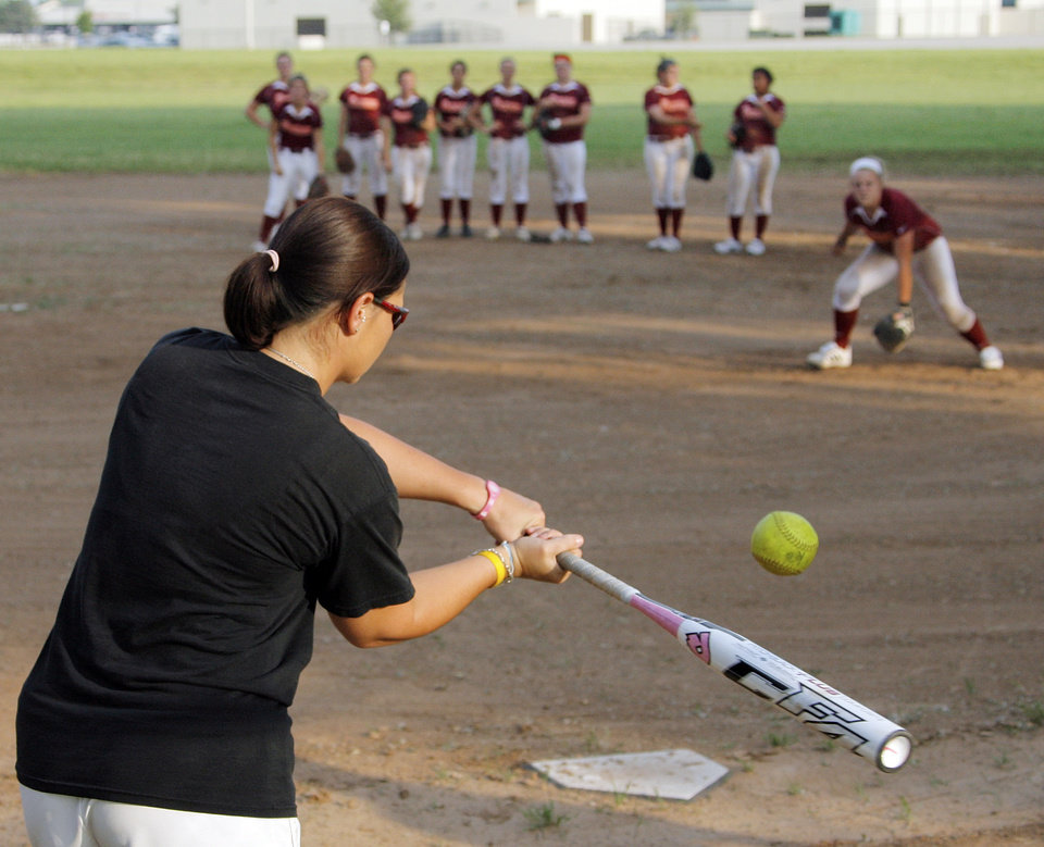 Photo - Coach Mandy Fulton hits the ball during a fielding drill at practice for the OKC Strikkers softball team in Oklahoma City, Thursday, May 27, 2010.  Mandy Fulton was a member of OU's national championship softball team in 2000. Photo by Nate Billings, The Oklahoman