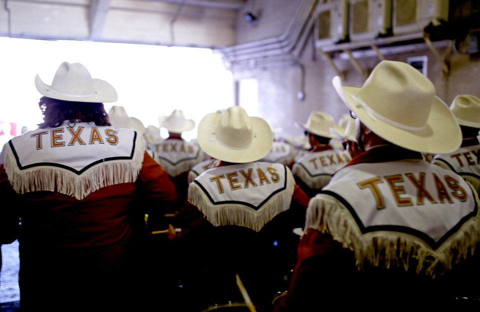 Photo - The Texas band walks on to the field before the Red River Showdown college football game between the University of Oklahoma Sooners (OU) and the Texas Longhorns (UT) at Cotton Bowl Stadium in Dallas, Saturday, Oct. 12, 2019. [Sarah Phipps/The Oklahoman]