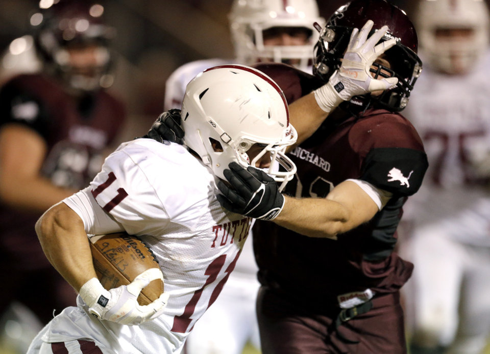Tuttle's Jesse Gregory tries to get by Blanchard's Parker Randels during the high school football game between Blanchard and Tuttle in Blanchard,Okla.,  Friday, Nov. 8, 2013. Photo by Sarah Phipps, The Oklahoman