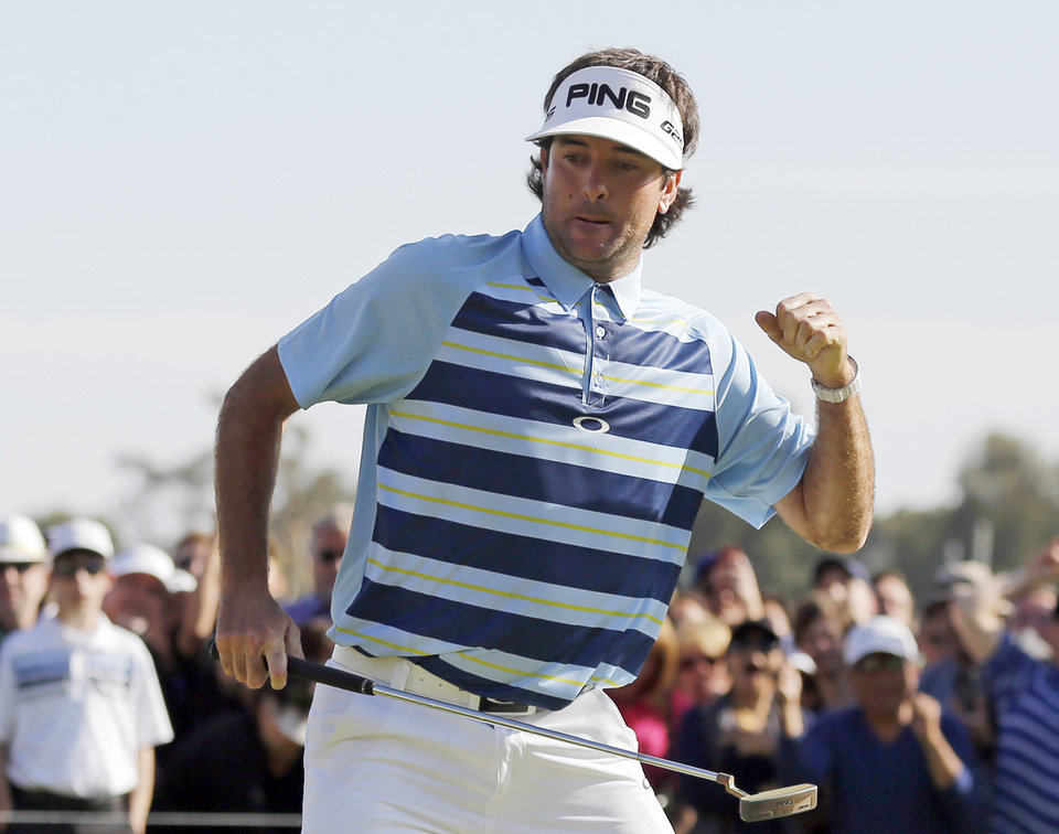 Photo - Bubba Watson celebrates his birdie putt on the 18th green on his way to victory in the Northern Trust Open golf tournament at Riviera Country Club in the Pacific Palisades area of Los Angeles, Sunday, Feb. 16, 2014. Watson carded a 15-under-par 269, two strokes ahead of the second-place finisher. (AP Photo/Reed Saxon)