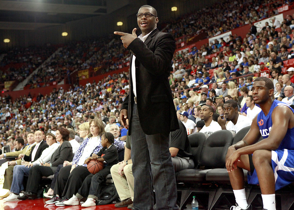 Photo - Desmond Mason, Head Coach of the Blue Team, talks with an official during the US Fleet Tracking Basketball Invitational at the Cox Convention Center in Oklahoma City Sunday, Oct. 23, 2011. Photo by John Clanton, The Oklahoman