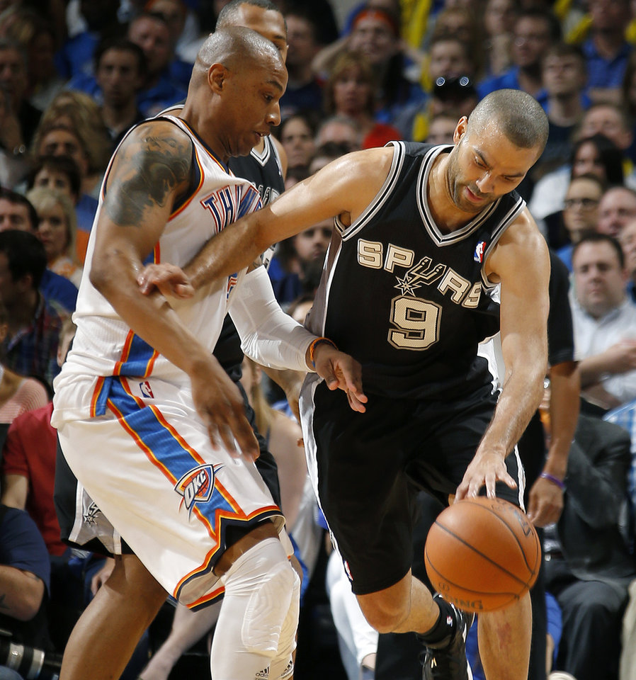 Photo - Oklahoma City's Caron Butler (2) defends San Antonio's Tony Parker (9) during an NBA basketball game between the Oklahoma City Thunder and the San Antonio Spurs at Chesapeake Energy Arena in Oklahoma City, Thursday, April 3, 2014. Photo by Bryan Terry, The Oklahoman