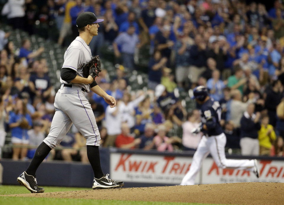 Photo - Colorado Rockies starting pitcher Christian Friedrich walks back to the mound after giving up a two-run home run to Milwaukee Brewers' Aramis Ramirez during the first inning of a baseball game Thursday, June 26, 2014, in Milwaukee. (AP Photo/Morry Gash)