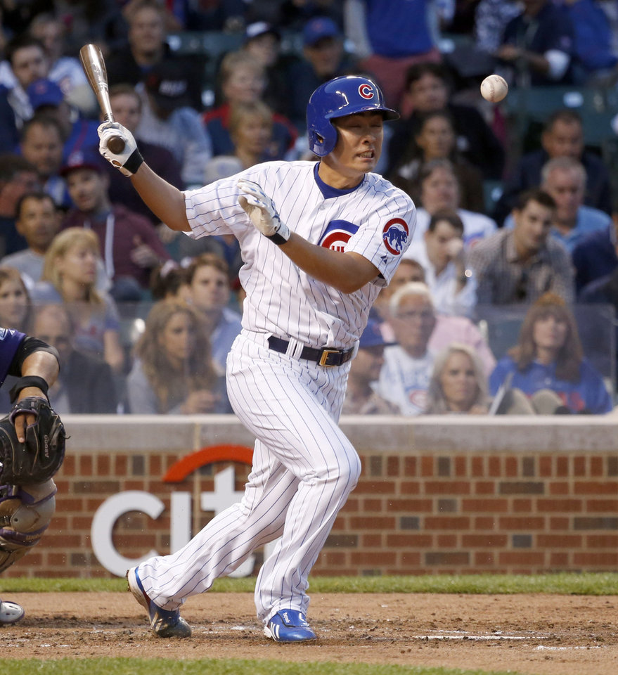 Photo - Chicago Cubs' Tsuyoshi Wada fouls off a pitch from Colorado Rockies starting pitcher Yohan Flande during the third inning of a baseball game Monday, July 28, 2014, in Chicago. (AP Photo/Charles Rex Arbogast)