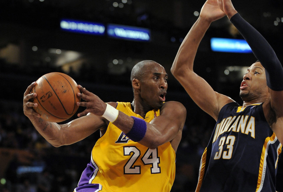 Photo - Los Angeles Lakers guard Kobe Bryant (24) goes up for a shot as Indiana Pacers forward Danny Granger (33) defends during the second half of their NBA basketball game, Friday, Jan. 9, 2009, in Los Angeles. The Lakers won 121-119. (AP Photo/Mark J. Terrill)  ORG XMIT: OTKMT101