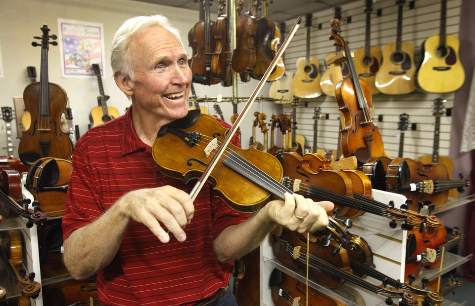 Photo - Internationally acclaimed fiddler Byron Berline performs at his Double Stop Fiddle Shop in Guthrie on Wednesday, July 25 , 2012. Photo By David McDaniel/The Oklahoman Archives  David McDaniel - The Oklahoman