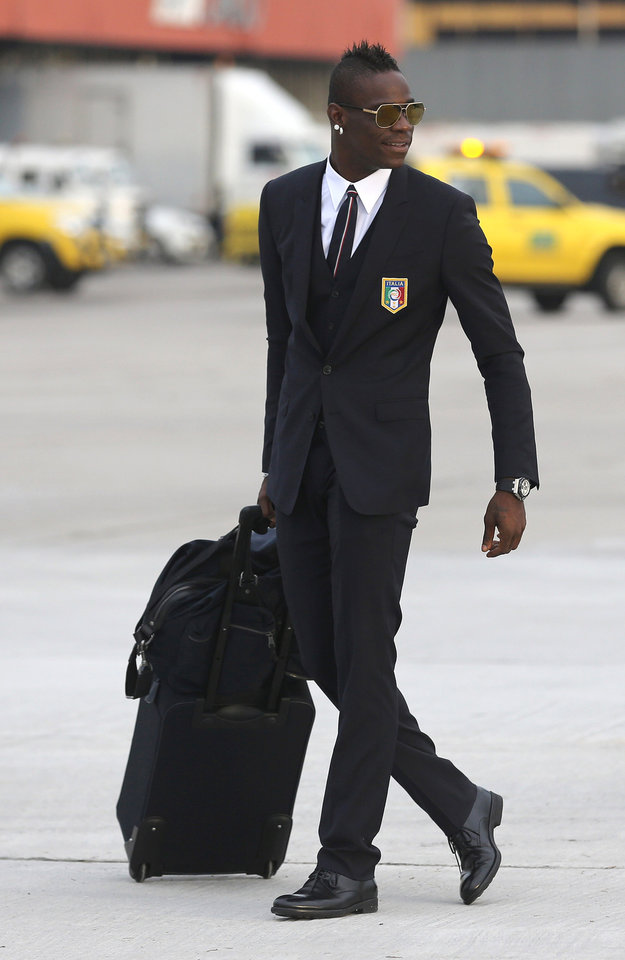 Photo - Italy's soccer player Mario Balotelli arrives with his team at the Galeao Air Base in Rio de Janeiro, Brazil, Friday, June 6, 2014. The Italian team will be based at a resort in Mangaratiba during the World Cup.  (AP Photo/Leo Correa)