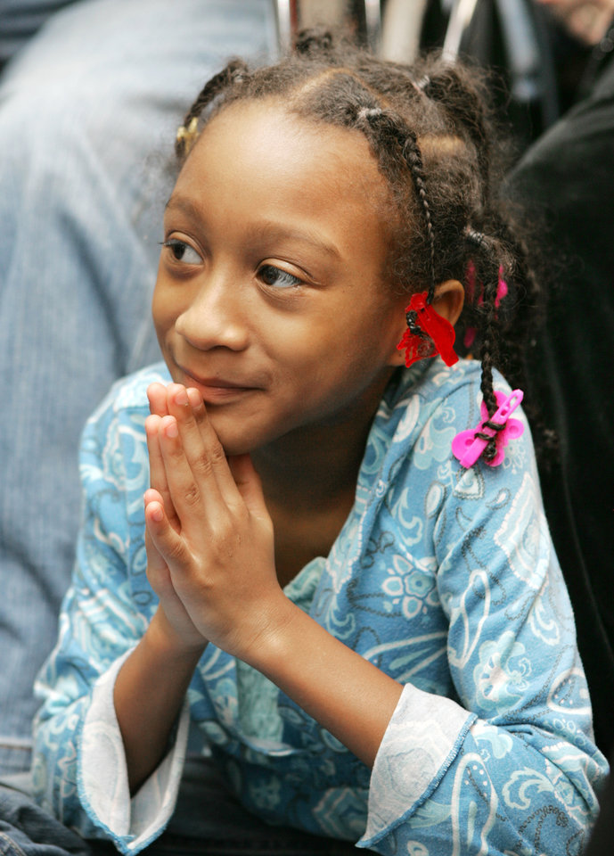 Photo - 9 year-old Alexia Grant watches the Inauguration of President Barack Obama  at the Freedom Center at NE 26th and Martin Luther King Blvd. in Oklahoma City. January  20, 2009.  BY STEVE GOOCH, THE  OKLAHOMAN.