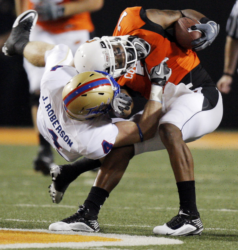 OSU's Michael Harrison (7) is tackled by James Roberson (4) of TU during the college football game between the University of Tulsa (TU) and Oklahoma State University (OSU) at Boone Pickens Stadium in Stillwater, Oklahoma, Saturday, September 18, 2010. OSU won, 65-28. Photo by Nate Billings, The Oklahoman