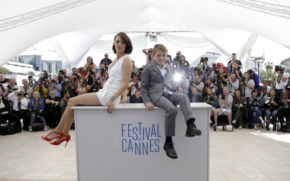 Photo - Actress Berenice Bejo, left, and actor Abdul Khalim Mamatsueiv  pose for photographers during a photo call for The Search at the 67th international film festival, Cannes, southern France, Wednesday, May 21, 2014. (AP Photo/Thibault Camus)