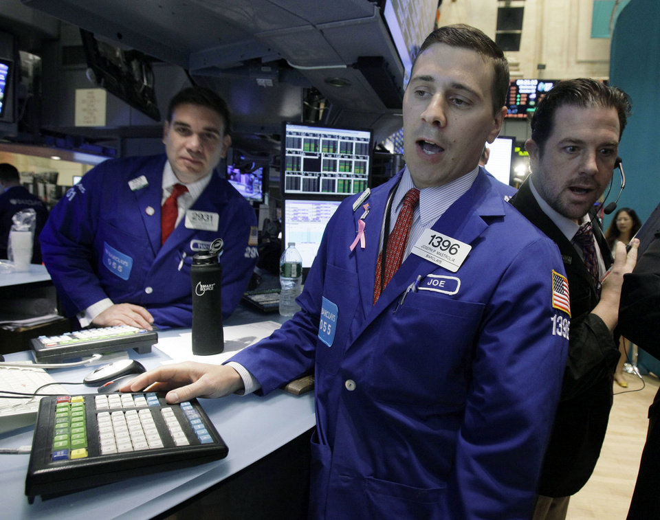 Photo -   Specialist Joseph Mastrolia, center, works at his post on the floor of the New York Stock Exchange Wednesday, Oct. 3, 2012. Stocks are mostly higher in early trading on Wall Street Wednesday after a measure of private sector hiring came in better than economists were expecting. (AP Photo/Richard Drew)