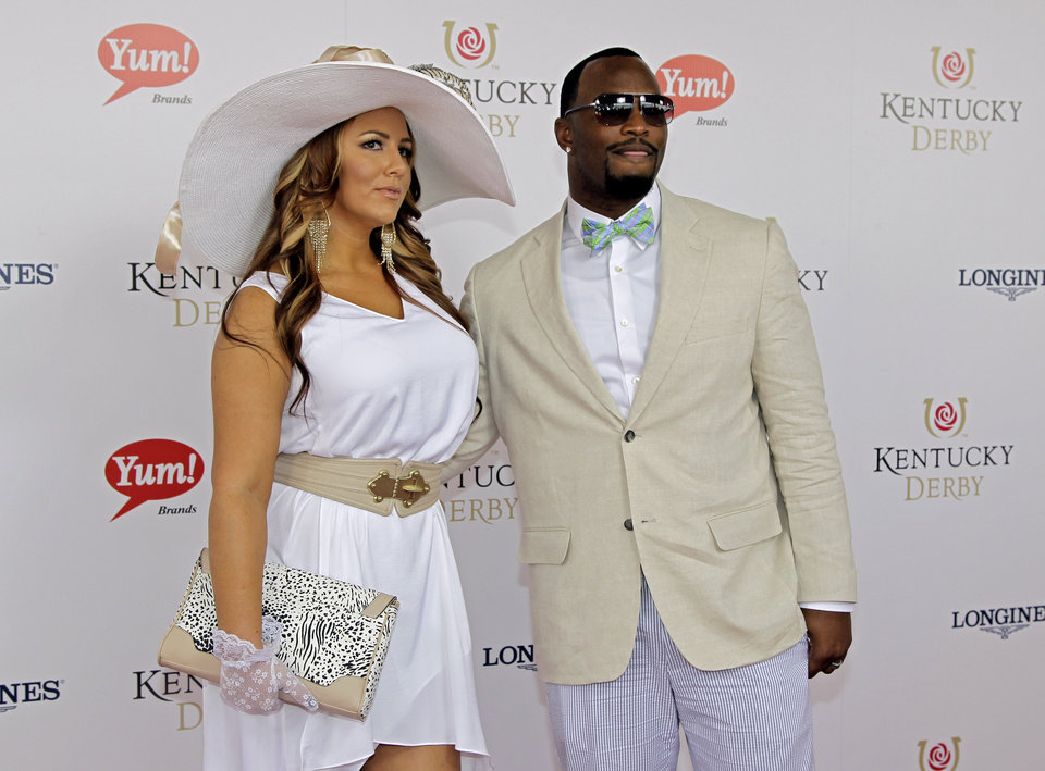 Photo - Oakland Raiders fullback Marcel Reece arrives with a companion for the 138th Kentucky Derby horse race at Churchill Downs Saturday, May 5, 2012, in Louisville, Ky. (AP Photo/Darron Cummings)  ORG XMIT: DBY138