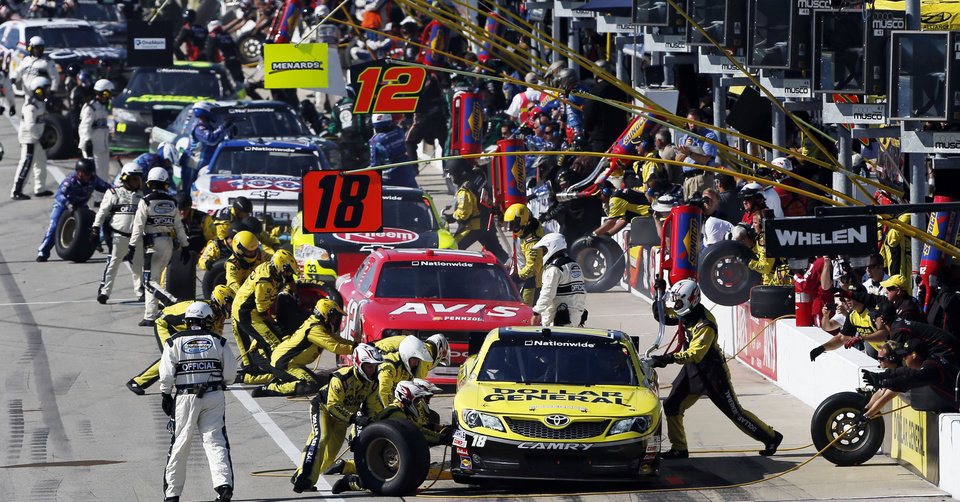 Photo -   Drivers make pit stops during the NASCAR Nationwide Series auto race at Chicagoland Speedway in Joliet, Ill., Saturday, Sept. 15, 2012. (AP Photo/Tim Stewart)