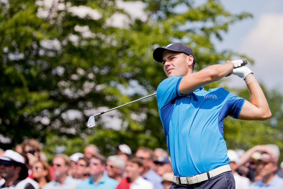 Photo - US open winner Martin Kaymer of Germany  watches his shot  during the BMW  International Open golf tournament  in Pulheim near Cologne, Germany,  Thursday June 26, 2014.  (AP Photo/dpa, Rolf Vennenbernd)