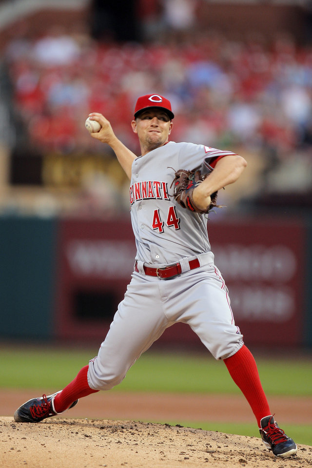 Photo - Cincinnati Reds starting pitcher Mike Leake throws during the first inning of a baseball game against the St. Louis Cardinals, Monday, Aug. 18, 2014, in St. Louis. (AP Photo/Scott Kane)