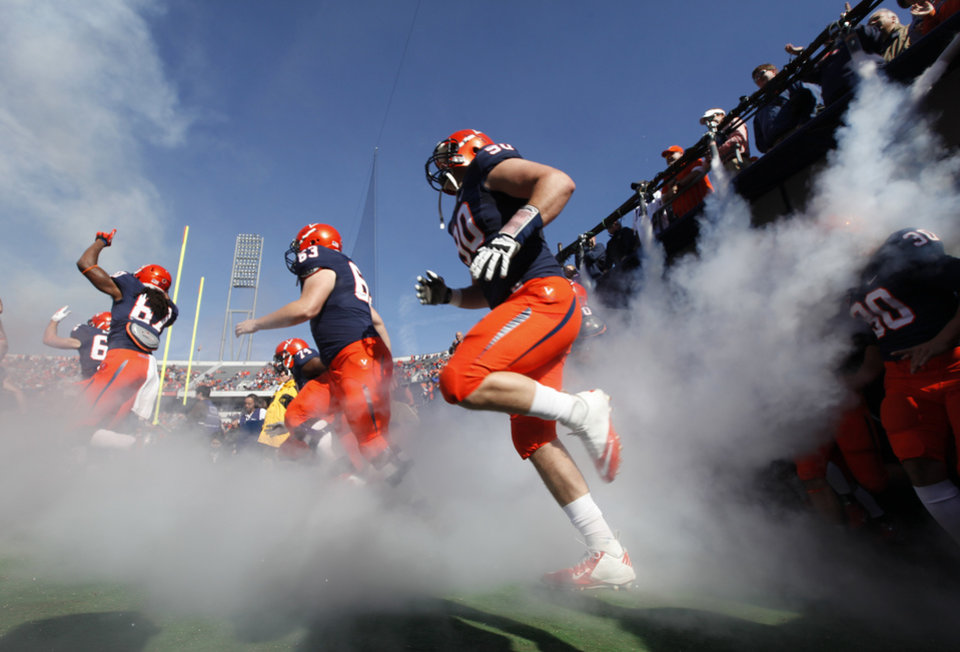 Photo -   Virginia football players run onto the field for an NCAA college football game against Maryland at Scott Stadium in Charlottesville, Va., Saturday, Oct. 13, 2012. (AP Photo/Steve Helber)