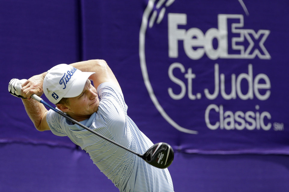 Photo - Peter Malnati tees off on the 17th hole during the second round of the St. Jude Classic golf tournament Saturday, June 7, 2014, in Memphis, Tenn. Bad weather on Friday caused the second round to continue into Saturday. (AP Photo/Mark Humphrey)