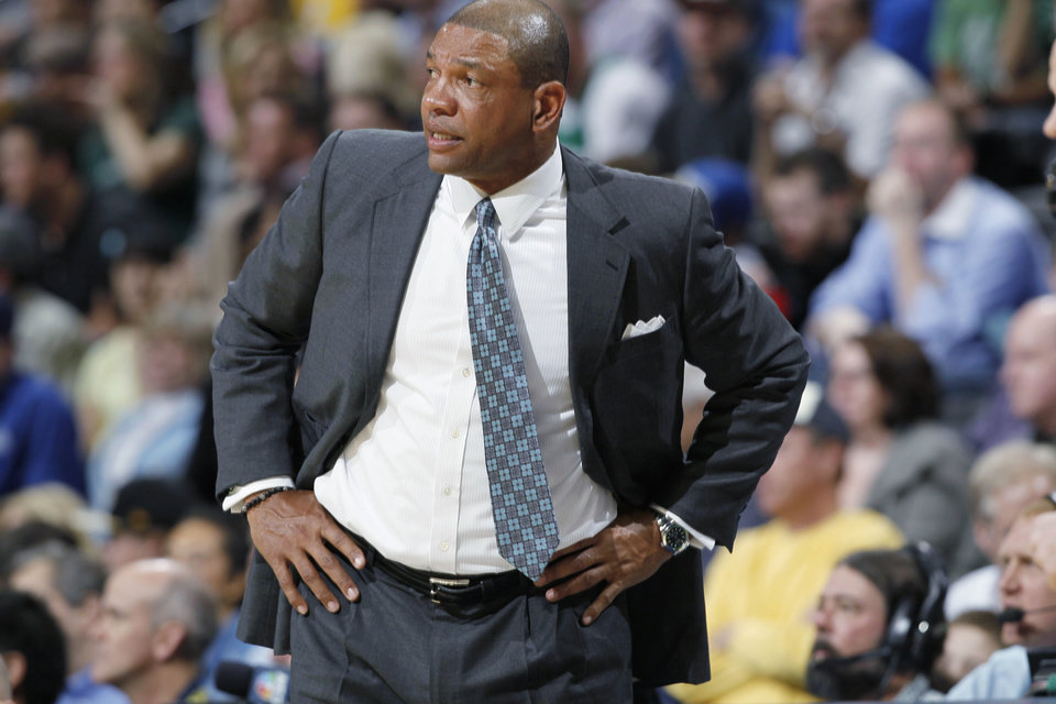 Photo - Boston Celtics coach Doc Rivers reacts to a Celtics turnout in the first quarter of an NBA basketball game against the Denver Nuggets in Denver on Tuesday, Feb. 19, 2013. (AP Photo/David Zalubowski)