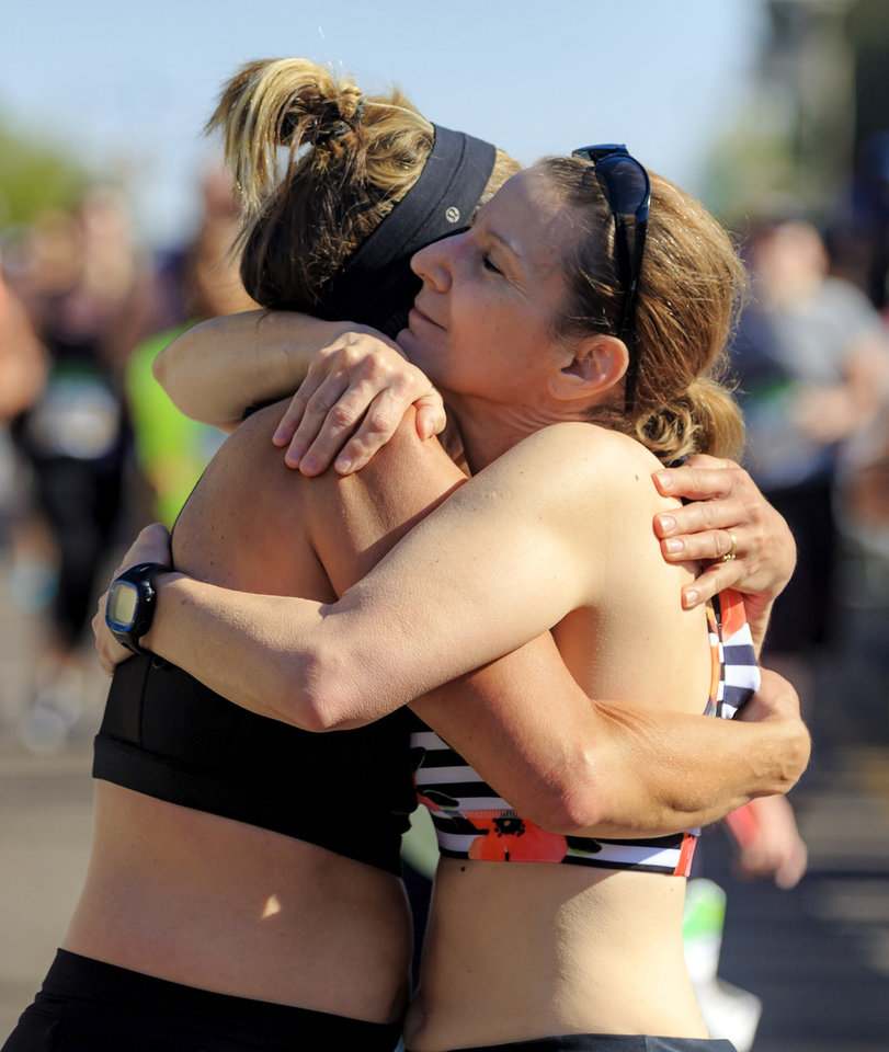 Photo - Reeda Frampton, right, hugs Debbie Frampton after they finish the half marathon together during the Oklahoma City Marathon in Oklahoma City, Okla. on Sunday, April 29, 2018.  . Photo by Chris Landsberger, The Oklahoman