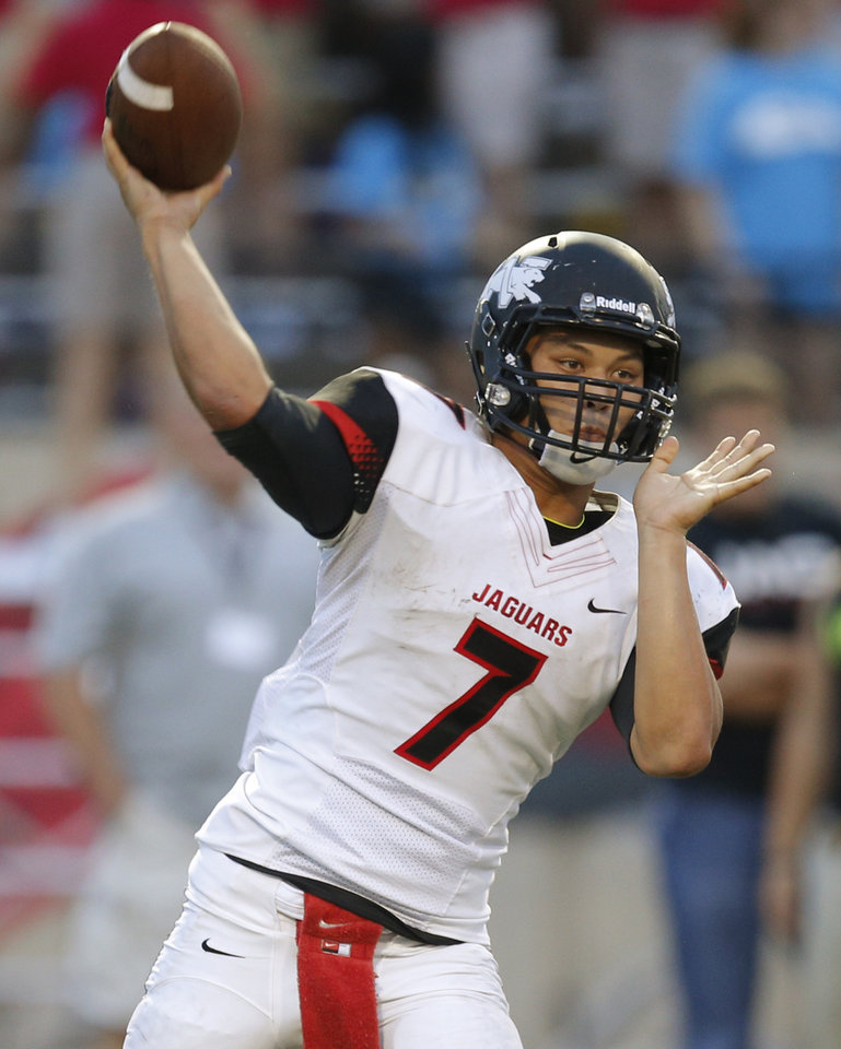 Photo - Westmoore's Bryson Lee throws a pass against Southmoore during their high school football game in Moore, Okla., Friday, Sept. 13, 2013. Photo by Bryan Terry, The Oklahoman