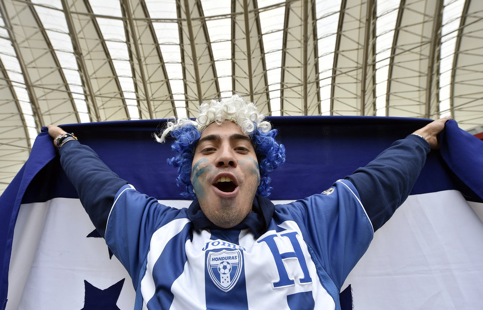 Photo - A fan from Honduras cheers before the group E World Cup soccer match between France and Honduras at the Estadio Beira-Rio in Porto Alegre, Brazil, Sunday, June 15, 2014.  (AP Photo/Martin Meissner)
