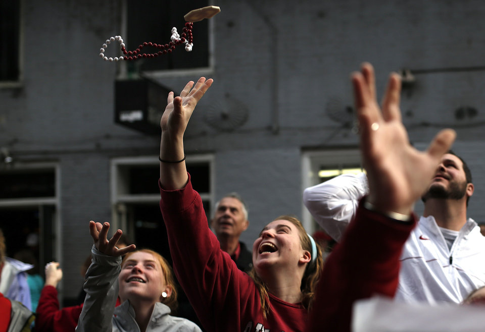 Photo - Oklahoma fans catch beads on Bourbon Street in the French Quarter, Thursday, Jan. 2, 2014 in New Orleans. Photo by Sarah Phipps, The Oklahoman