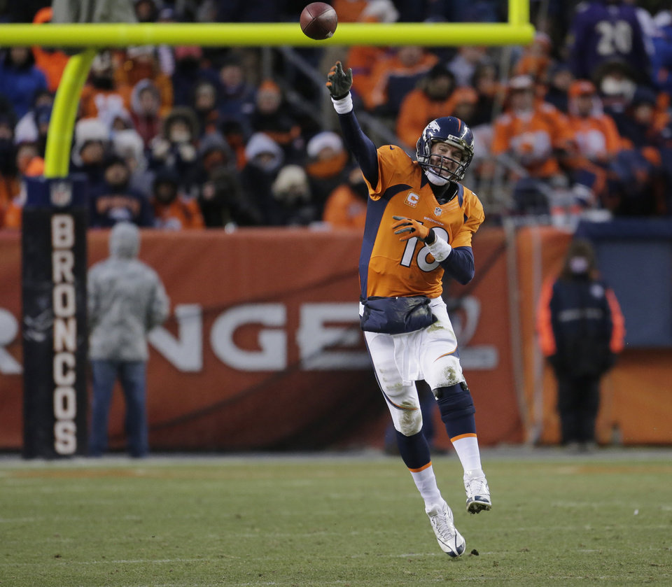 Denver Broncos quarterback Peyton Manning passes against the Baltimore Ravens in the third quarter of an AFC divisional playoff NFL football game, Saturday, Jan. 12, 2013, in Denver. (AP Photo/Charlie Riedel)