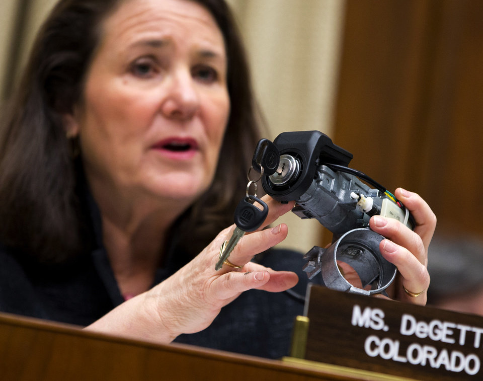 Photo - FILE - In this April 1, 2014 file photo, Rep. Diana DeGette, D-Colo., ranking member of the House Oversight and Investigations subcommittee, holds up a GM ignition switch while she questions General Motors CEO Mary Barra on Capitol Hill in Washington. Responding to complaints about