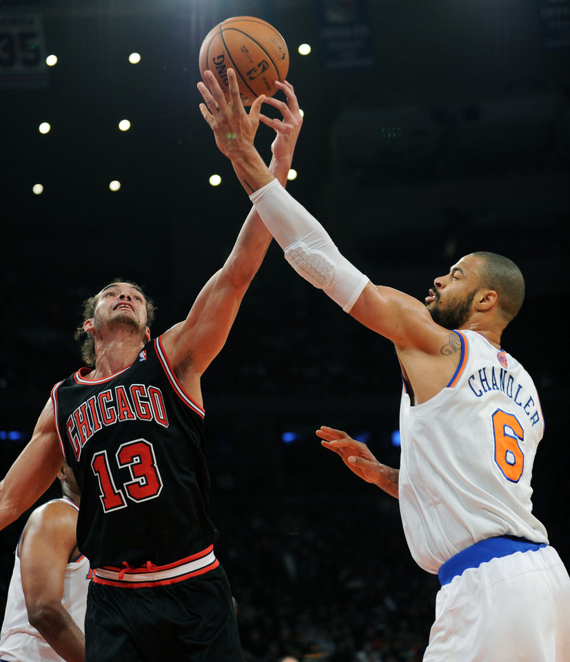 Photo - New York Knicks' Tyson Chandler, right, battles for a rebound with Chicago Bulls' Joakim Noah during the first half of an NBA basketball game Friday, Jan. 11, 2013, at Madison Square Garden in New York. (AP Photo/Bill Kostroun)