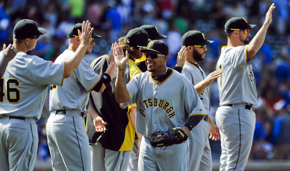 Photo - Pittsburgh Pirates right fielder Jose Tabata celebrates with teammates after the Pirates defeated the Chicago Cubs 2-1 during a baseball game, Sunday, June 22, 2014, in Chicago. (AP Photo/Matt Marton)