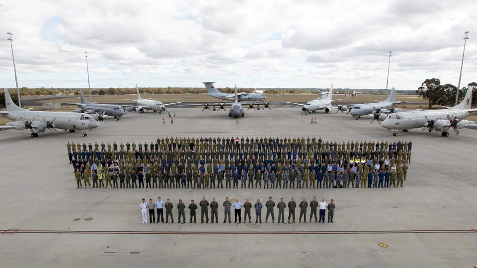 Photo - In this photo taken April 29, 2014 provided by the Australia Defence Force, multinational air-crew and aircraft involved in operation