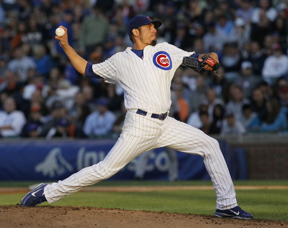 Photo -   Chicago Cubs starting pitcher Matt Garza delivers during the second inning of an interleague baseball game against the Detroit Tigers on Wednesday, June 13, 2012, in Chicago. (AP Photo/Charles Rex Arbogast)