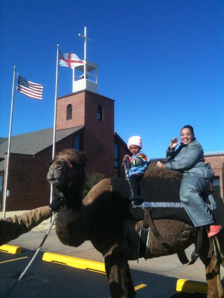 Members of St. Augustine of Canterbury Episcopal Church ride a camel as part of the Oklahoma City church's 2011 Epiphany activities at 14700 N May. Photo provided <strong></strong>