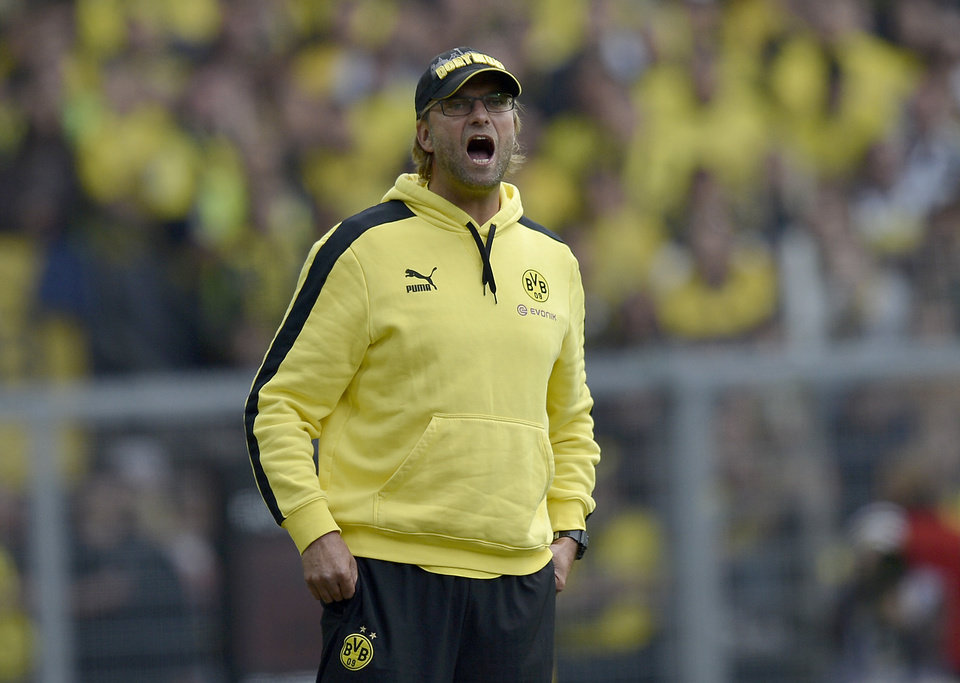Photo -   Dortmund's head coach Juergen Klopp reacts during the German first division Bundesliga soccer match between Borussia Dortmund and Bayer Leverkusen in Dortmund, Germany, Saturday, Sept. 15, 2012. (AP Photo/Martin Meissner) NO MOBILE USE UNTIL 2 HOURS AFTER THE MATCH, WEBSITE USERS ARE OBLIGED TO COMPLY WITH DFL-RESTRICTIONS, SEE INSTRUCTIONS FOR DETAILS
