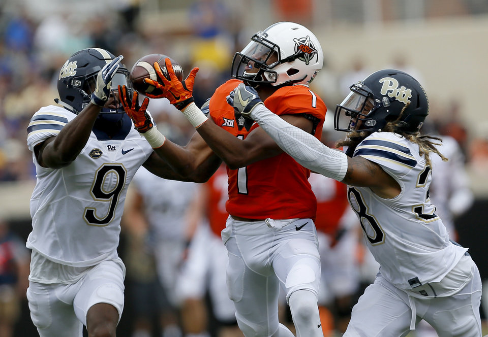 Photo - Oklahoma State's Jalen McCleskey (1) has a pass broken up by Pittsburgh's Jordan Whitehead (9) and Ryan Lewis (38) during a college football game between the Oklahoma State Cowboys (OSU) and the Pitt Panthers at Boone Pickens Stadium in Stillwater, Okla., Saturday, Sept. 17, 2016. Photo by Sarah Phipps, The Oklahoman