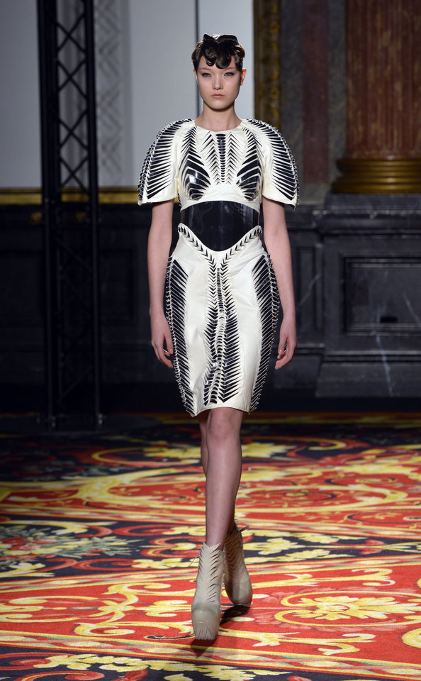 Photo - A model wears a creation by Dutch fashion designer Iris van Herpen for her Spring Summer 2013 Haute Couture fashion collection, presented in Paris, Monday, Jan.21, 2013. (AP Photo/Benjamin Girette)
