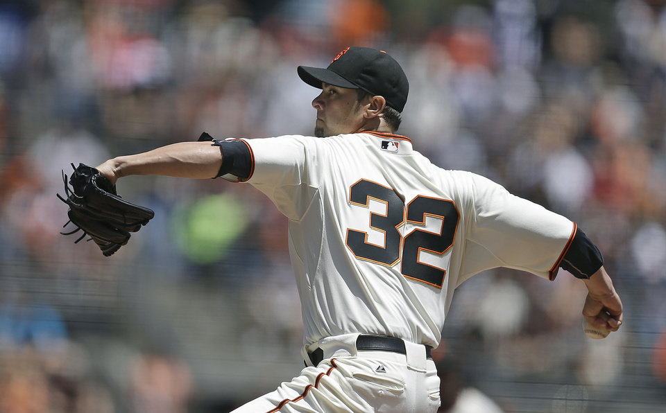 Photo - San Francisco Giants' Ryan Vogelsong works against the Arizona Diamondbacks in the first inning of a baseball game Saturday, July 12, 2014, in San Francisco. (AP Photo/Ben Margot)