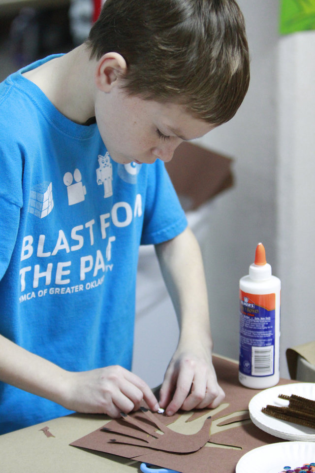 Jonathan Delozier, 11, makes some Christmas decorations during the Before and After School Care program at the YMCA in Edmond, Thursday, December 22 , 2011.   Photo by David McDaniel, The Oklahoman