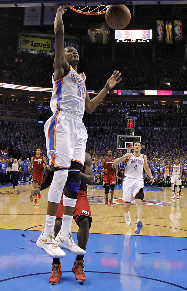 Oklahoma City's Kevin Durant (35) dunks the ball during Game 1 of the NBA Finals between the Oklahoma City Thunder and the Miami Heat at Chesapeake Energy Arena in Oklahoma City, Tuesday, June 12, 2012. Photo by Chris Landsberger, The Oklahoman