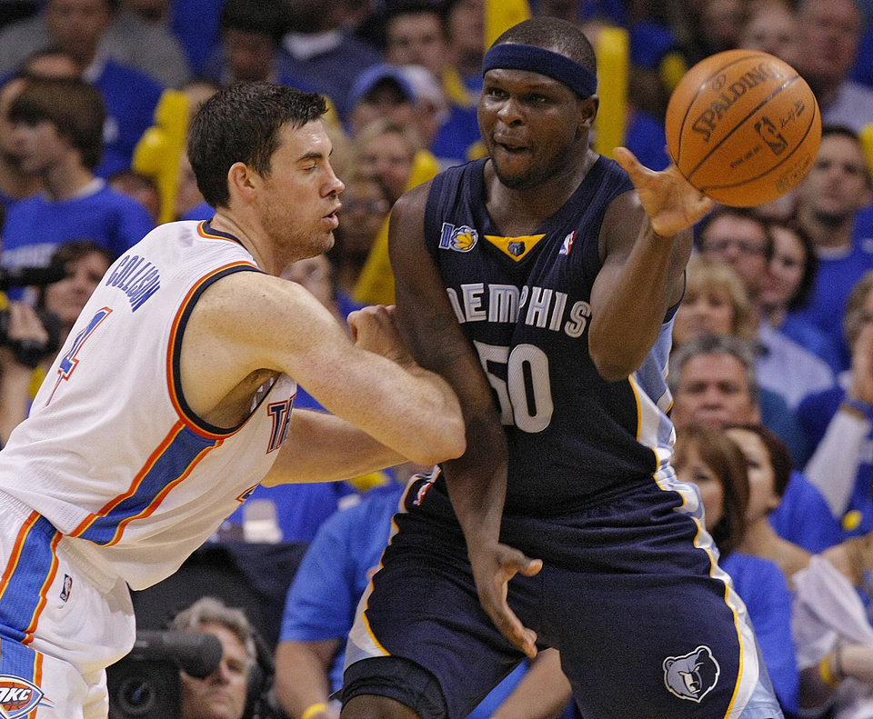 Photo - Oklahoma City's Nick Collison (4) defends on Zach Randolph (50) of Memphis during game two of the Western Conference semifinals between the Memphis Grizzlies and the Oklahoma City Thunder in the NBA basketball playoffs at Oklahoma City Arena in Oklahoma City, Tuesday, May 3, 2011. Photo by Chris Landsberger, The Oklahoman