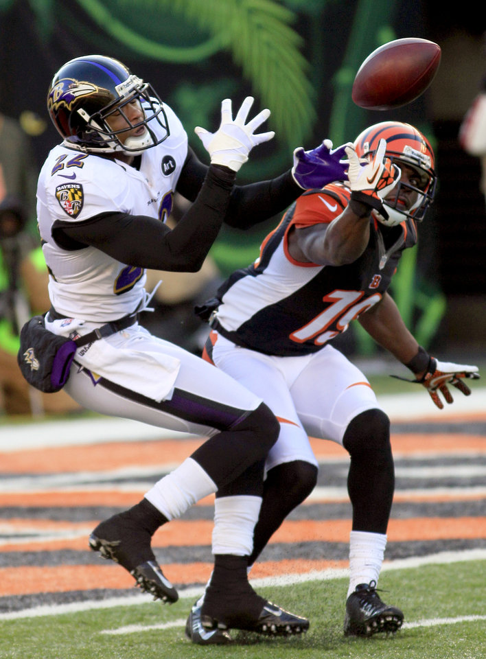 Photo - Baltimore Ravens cornerback Jimmy Smith (22) breaks up a pass intended for Cincinnati Bengals wide receiver Brandon Tate (19) in the second half of an NFL football game, Sunday, Dec. 30, 2012, in Cincinnati. (AP Photo/Tom Uhlman)