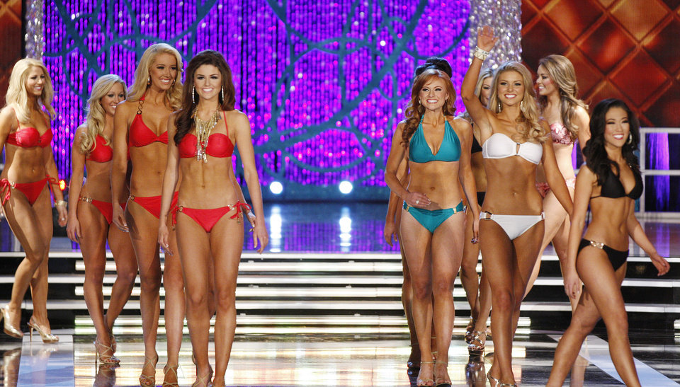Photo - Contestants compete in the swimsuit portion of the Miss America 2013 pageant on Saturday, Jan. 12, 2013, in Las Vegas. (AP Photo/Isaac Brekken)