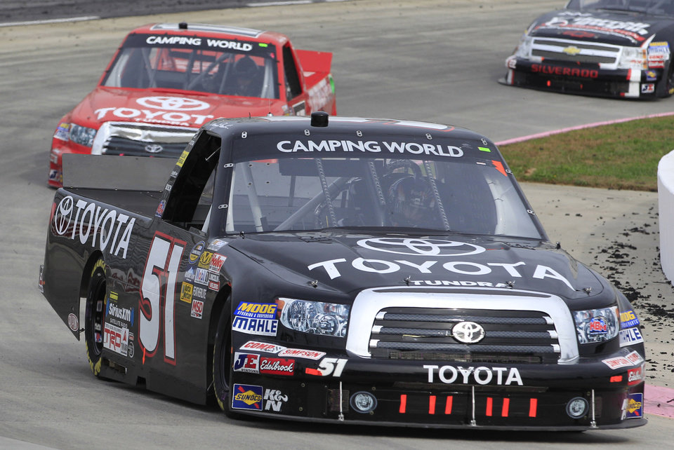 Photo -   Denny Hamlin (11) heads out of turn four during the NASCAR truck race at Martinsville Speedway in Martinsville, VA., Saturday, Oct. 27, 2012. Hamlin won the race. (AP Photo/Steve Helber)