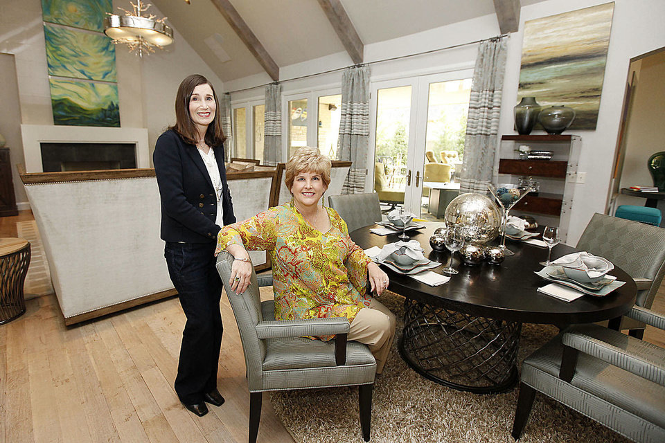 Photo - Dana Galiga, left, and Teresa Pope, co-chairmen, are shown in the living room of 1501 NW 158, one three new houses in this year's Symphony Show House fundraiser by the Oklahoma City Orchestra Leauge.  PAUL HELLSTERN - The Oklahoman