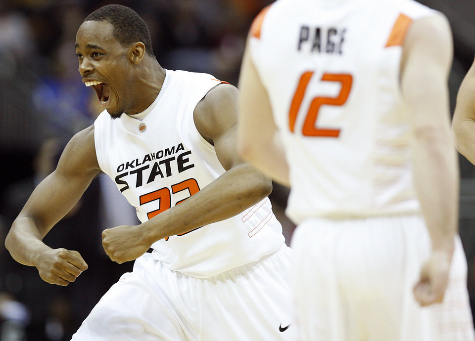 Photo - Oklahoma State's Roger Franklin (32) reacts after a Cowboy goal against Oklahoma in the first half of the college basketball game during the men's Big 12 Championship tournament at the Sprint Center on Wednesday, March 10, 2010, in Kansas City, Mo. Photo by Chris Landsberger, The Oklahoman