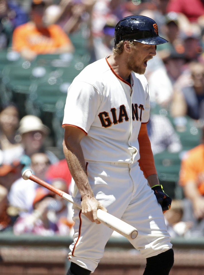 Photo - San Francisco Giants' Hunter Pence reacts after being called out on strikes facing Oakland Athletics starting pitcher Scott Kazmir in the third inning of their interleague baseball game Thursday, July 10, 2014, in San Francisco. (AP Photo/Eric Risberg)
