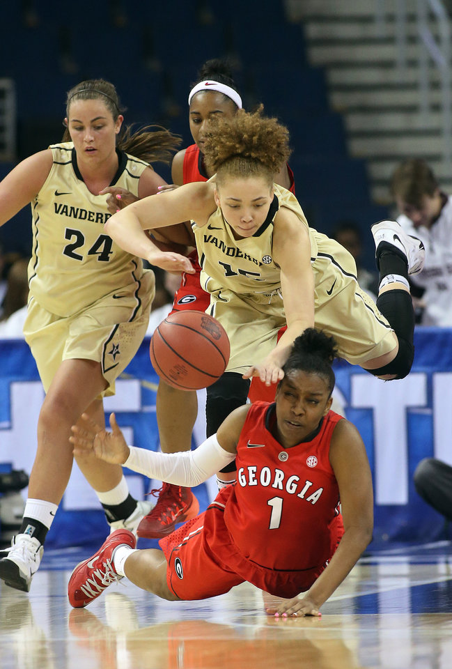 Photo - Georgia guard Khaalidah Miller (1) and Vanderbilt guard Jasmine Jenkins (15) chase down a loose ball in the second half of a second-round women's Southeastern Conference tournament NCAA college basketball game Thursday, March 6, 2014, in Duluth, Ga.  Georgia won 53-43. (AP Photo/Jason Getz)